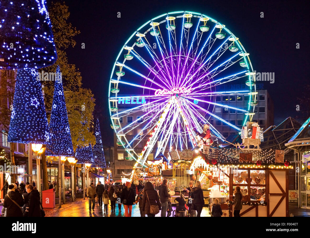 christmas market with ferris wheel in the evening germany north rhine westphalia