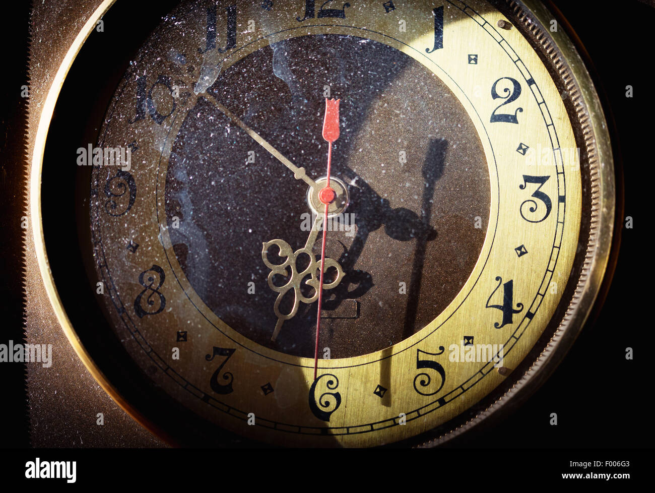 Vintage grunge clock face with vintage roman numerals - Stock Image