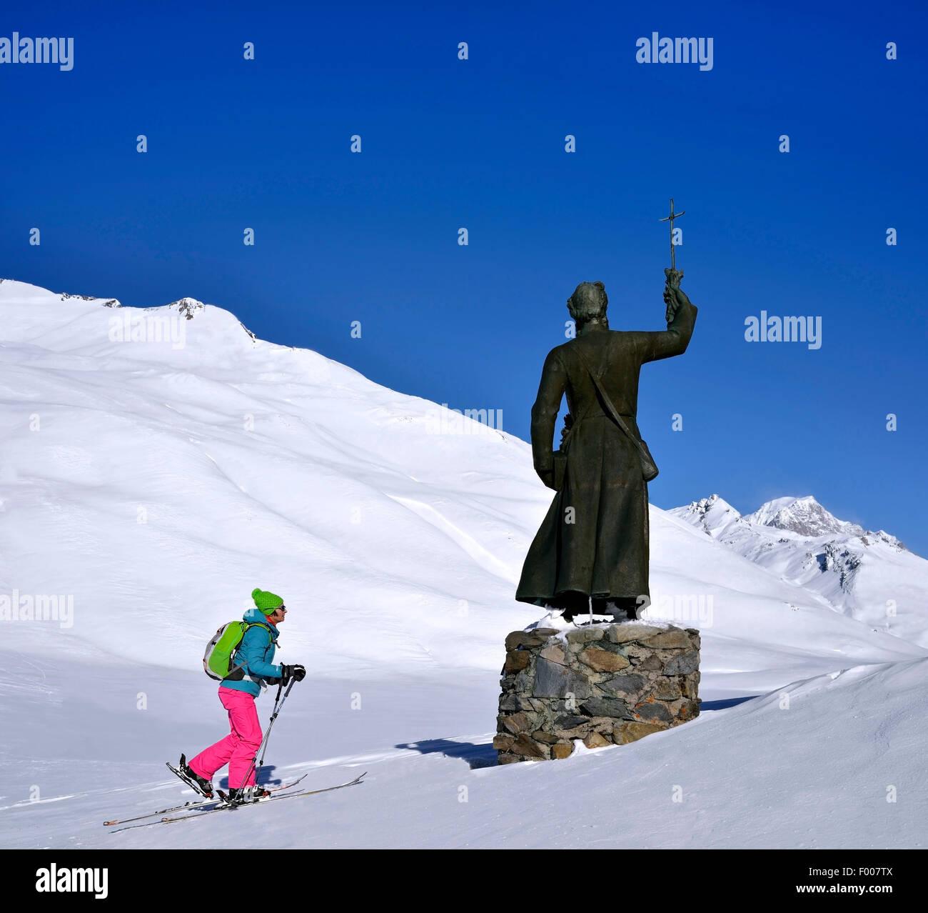 ski touring near the statue of Pierre Chanoux at Little St Bernard Pass, France, Savoie - Stock Image