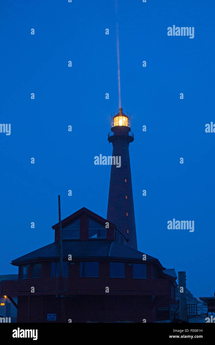 lighthouse of Andenes at night with snow fall, Vester�len, Insel And�ya, Andenes - Stock Image