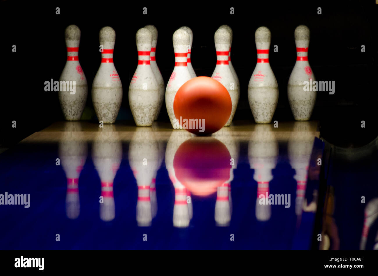 Bowling ball approaching the pins,indoor game - Stock Image