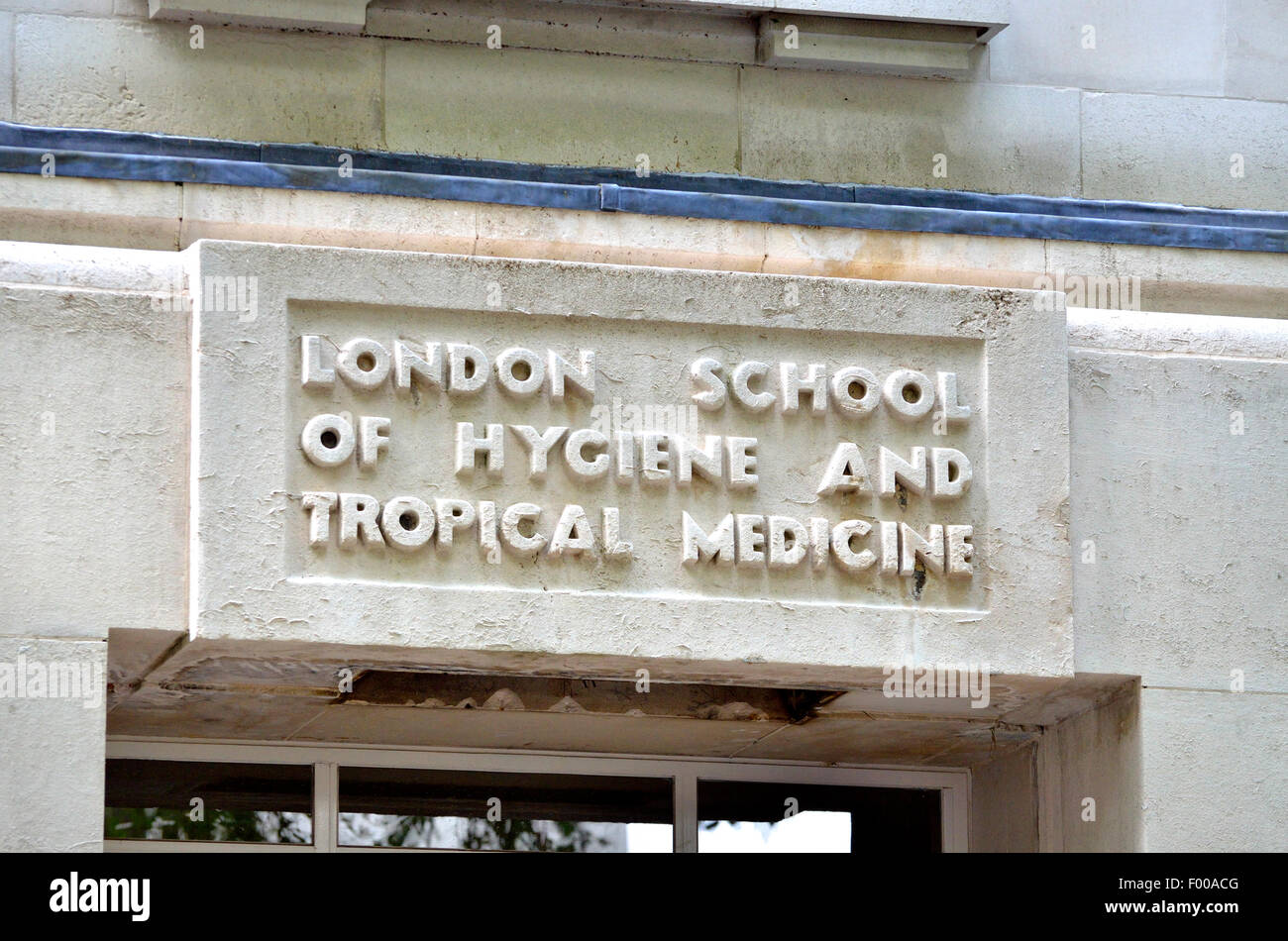 London, England, UK. London School of Hygiene and Tropical Medicine - detail above the main door on Gower Street Stock Photo