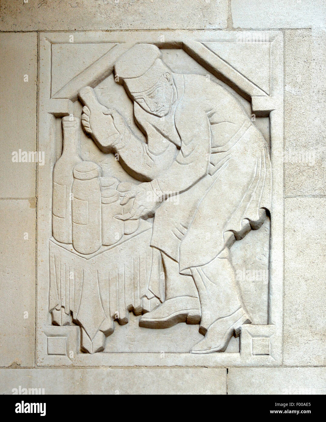 London, England, UK. College for the Distributive Trades, Charing Cross Road. Stone carving by Adolfine Ryland  - Stock Image