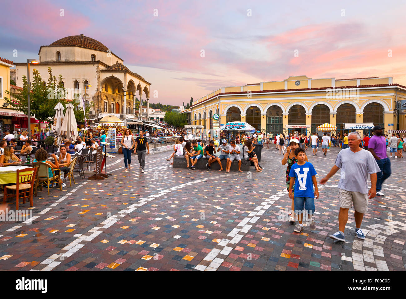 People at the mosque and metro station in Monastiraki square in Athens Stock Photo