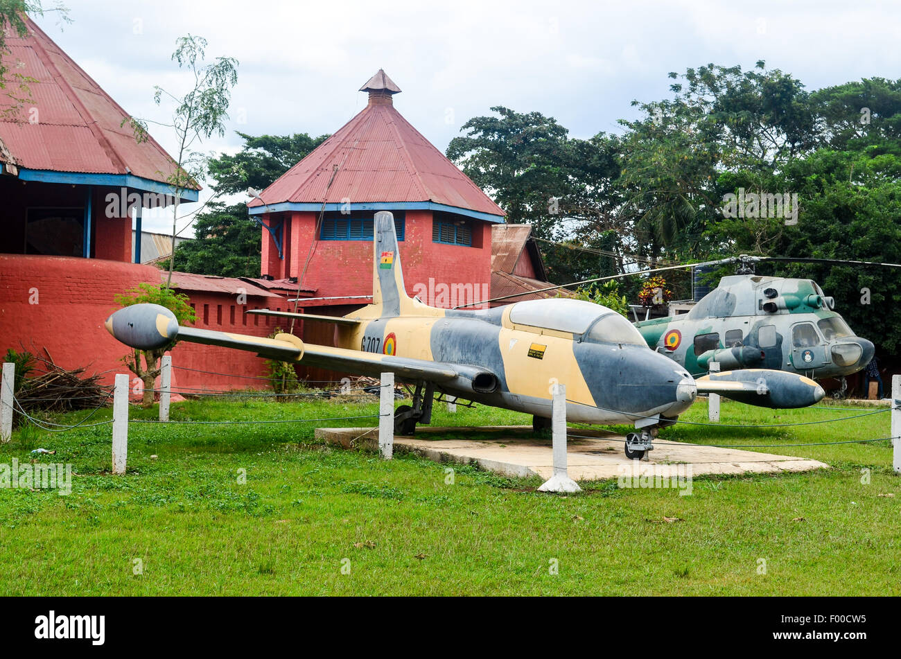 Military equipment (plane and helicopter) at the Kumasi Fort - Ghana Armed Forces Museum, with remains of colonial Stock Photo
