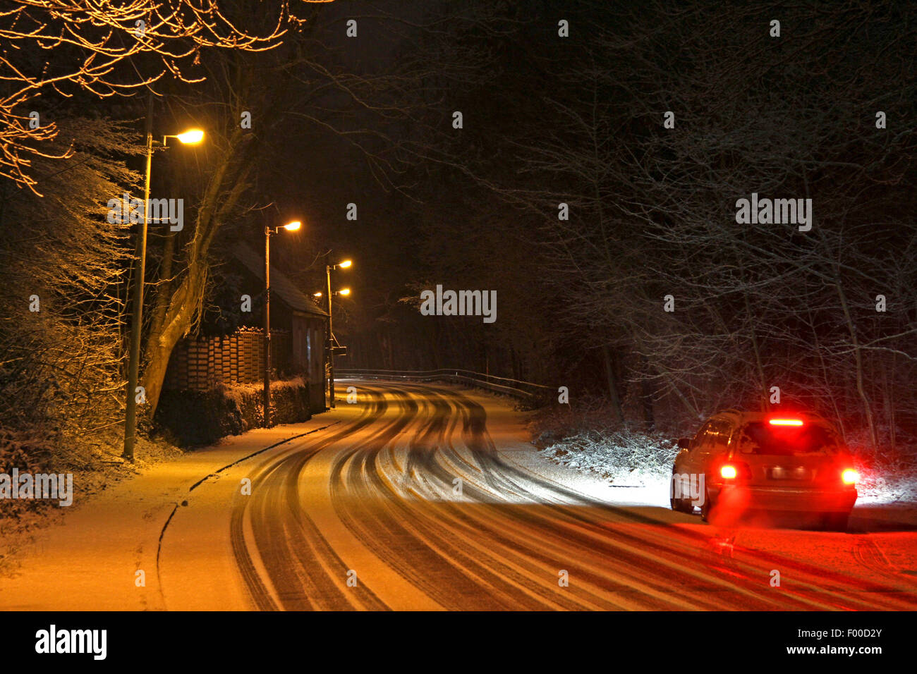 car stopping on slippery street after snowfall, Germany - Stock Image