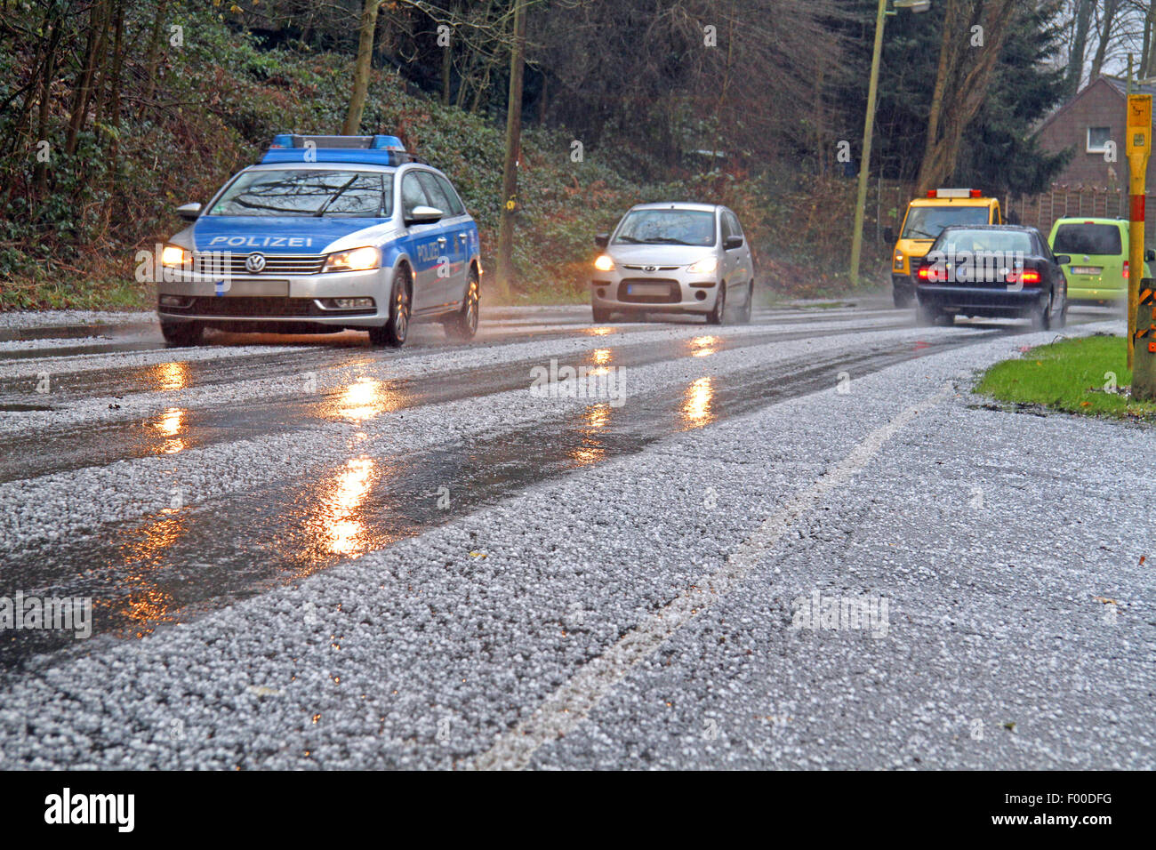 difficult traffic conditions during sleet shower, Germany - Stock Image