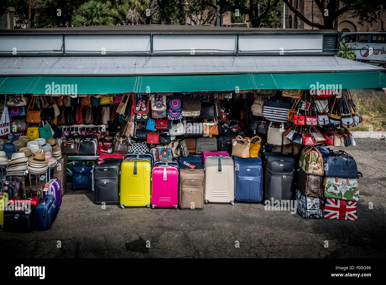 Street stall selling suitcases and bags. Rome. Italy. - Stock Image