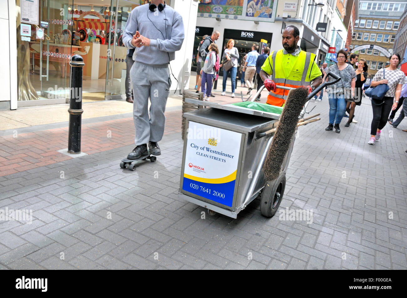 London, England, UK. Street cleaner in Carnaby Street Stock Photo