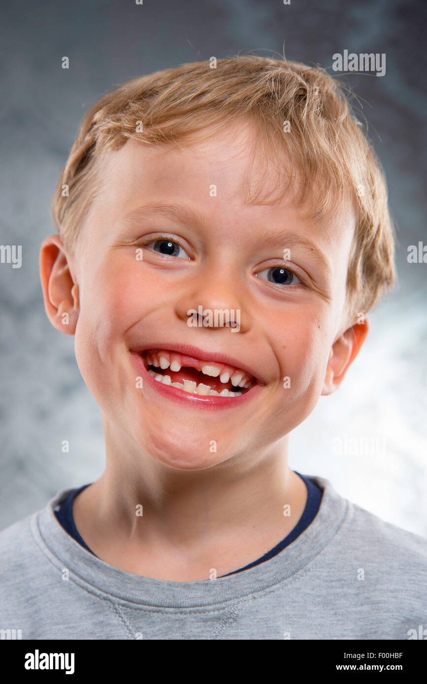 smiling six year old boy with tooth gap - Stock Image