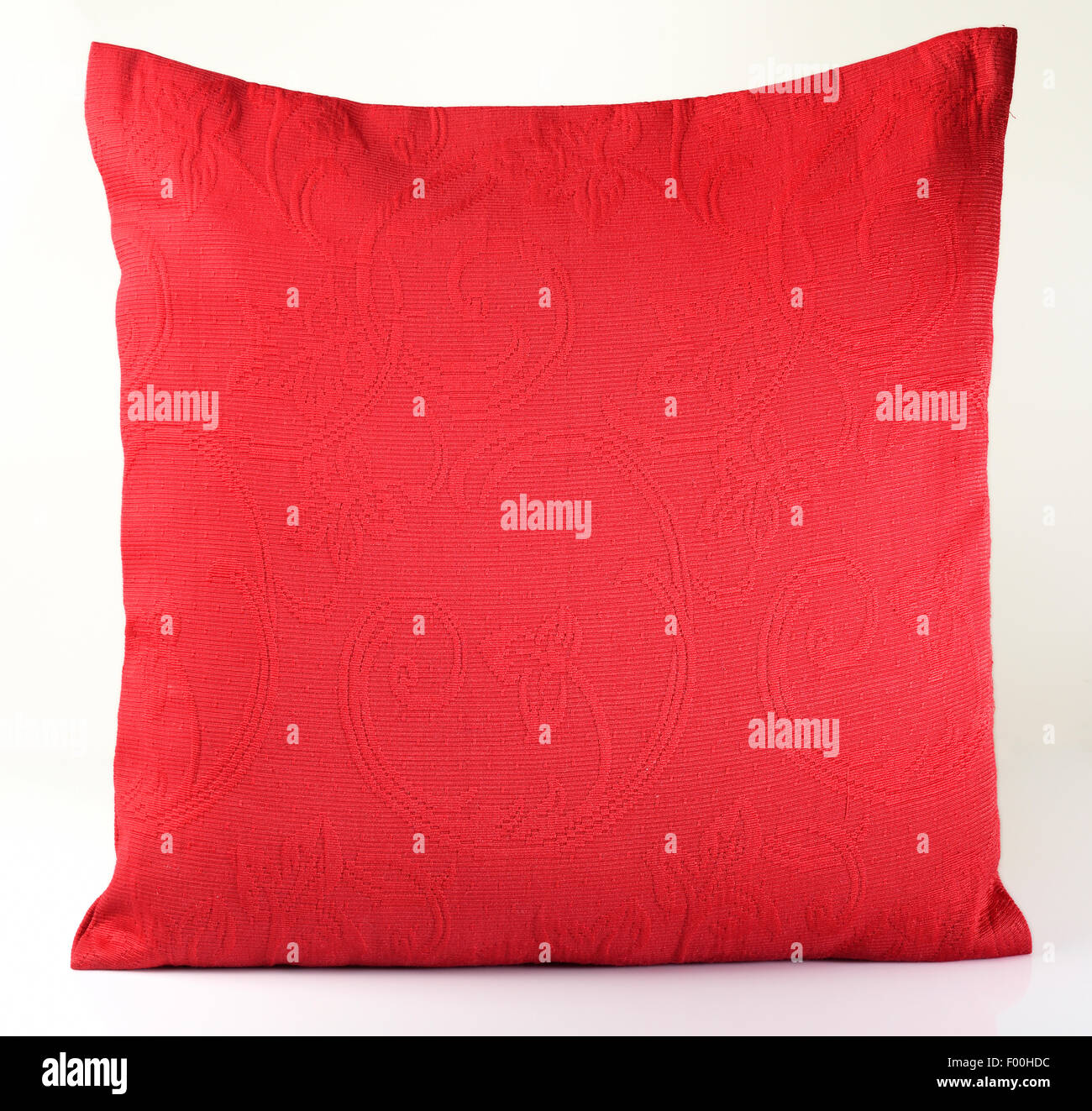 Red Pillow on white background - Stock Image