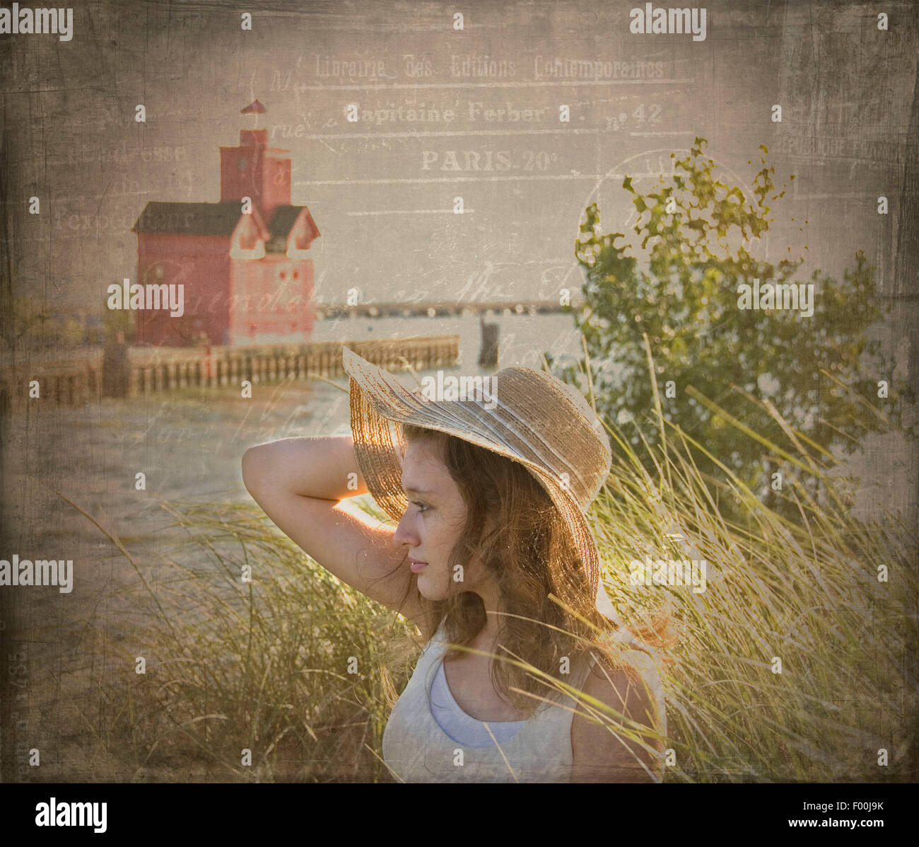 Young woman wearing a hat in beach grass with vintage texture overlay. - Stock Image