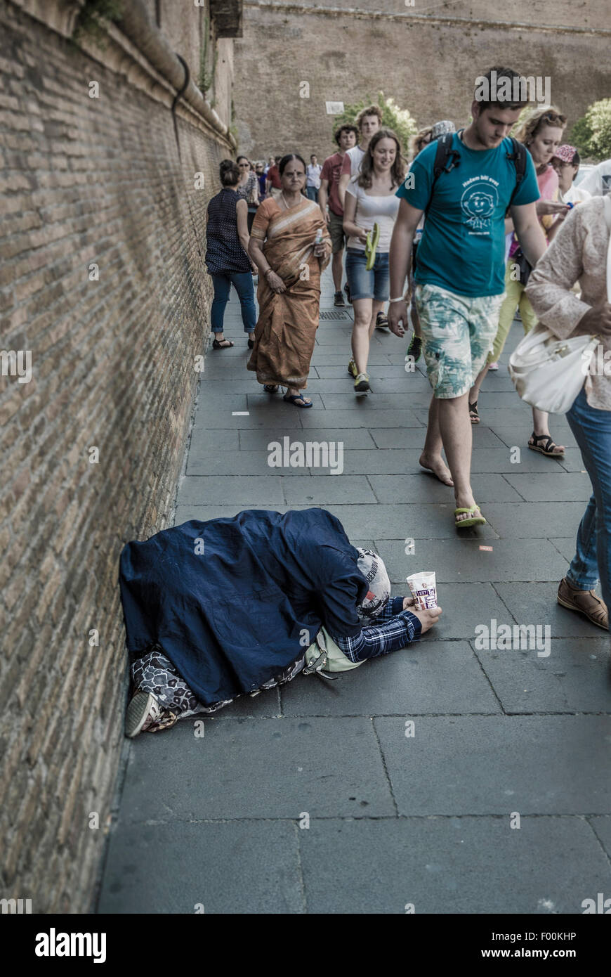 Woman street beggar outside the walls of the Vatican. Rome, Italy. - Stock Image