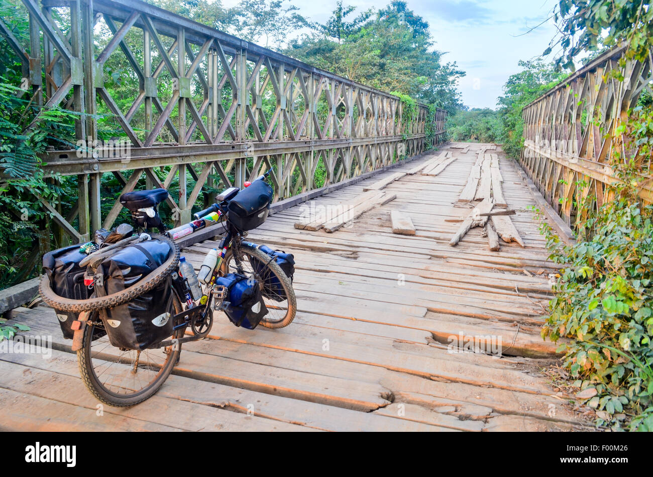 Bicycle touring in Ghana and cycling over an old colonial bridge - Stock Image