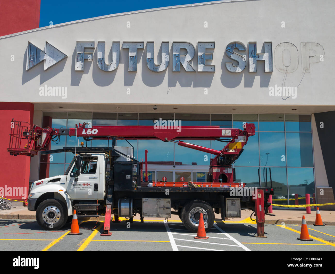 Sign being removed from closed Future Shop retail store seems to humorously foretell the future. Bayers Lake shopping Stock Photo