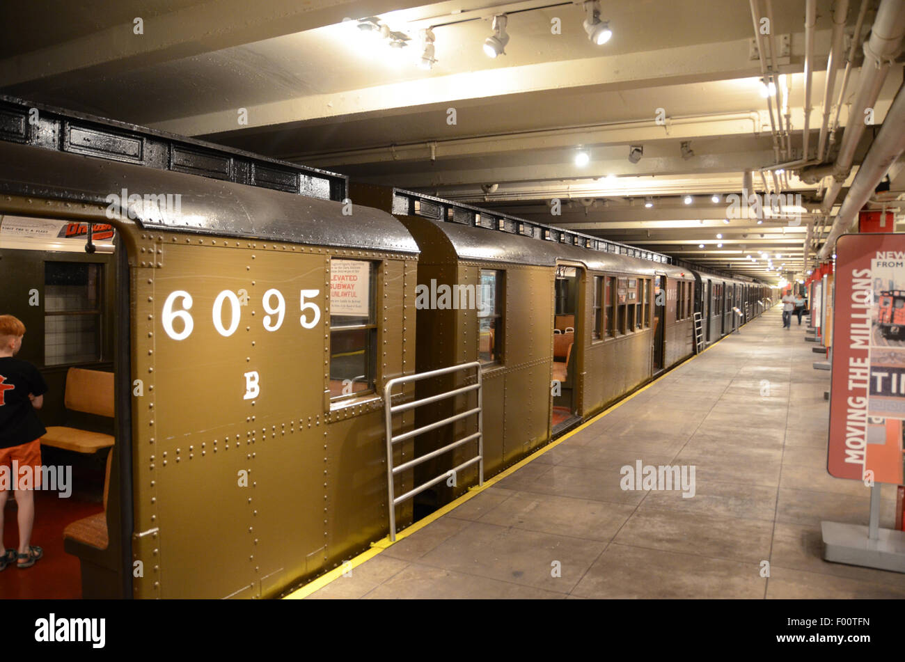 New York Transit Museum 1927 carriage subway vintage subway signs adverts rattan benches green livery exterior - Stock Image
