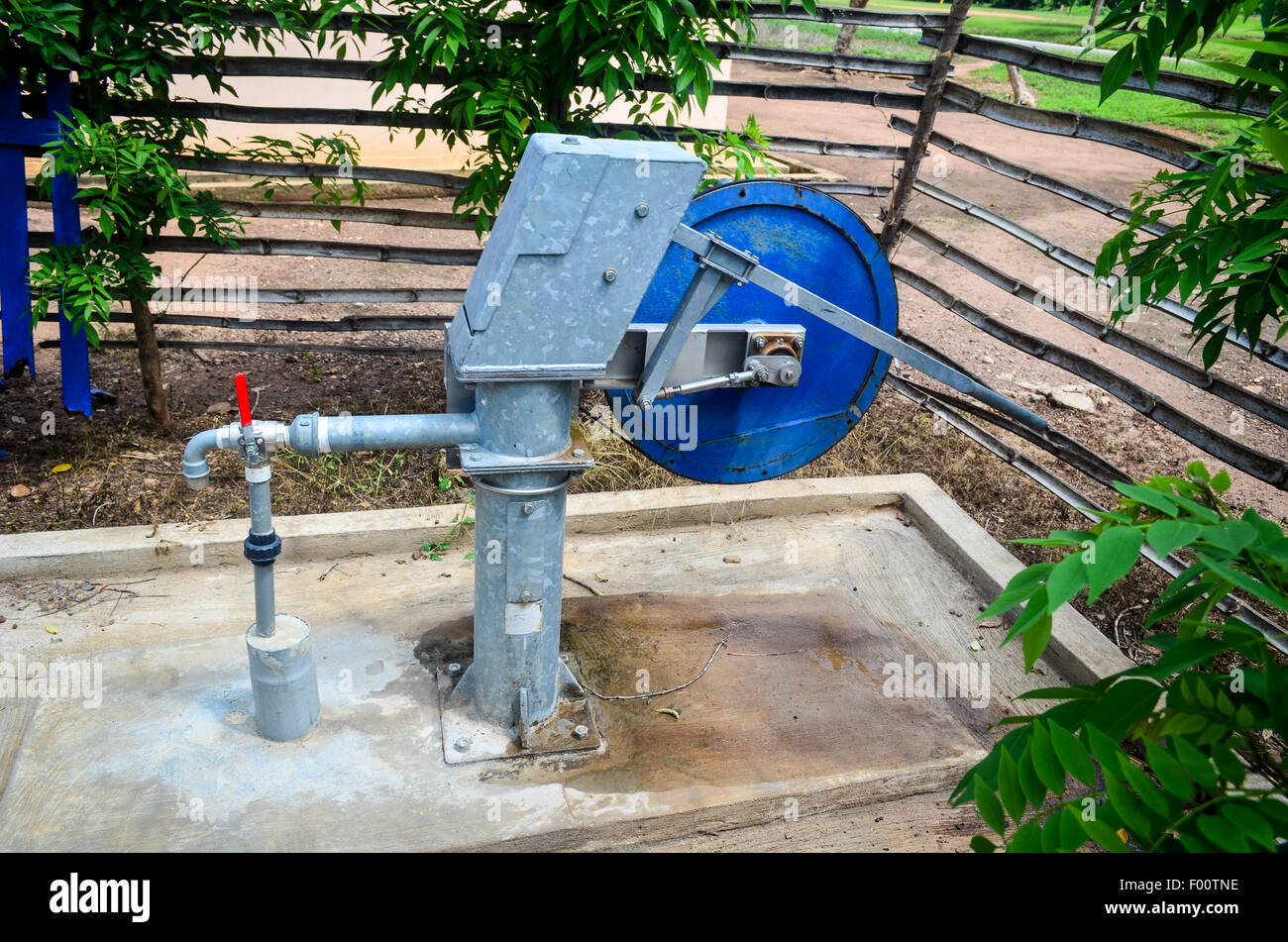 Automated well pump in the countryside of Ghana - Stock Image