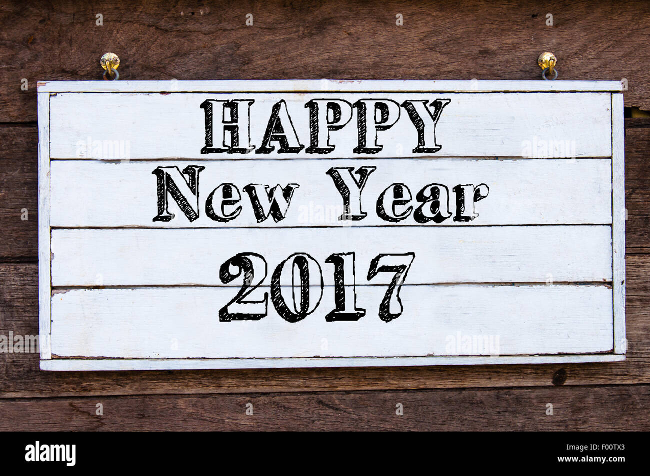 Happy New Year 2017 Inspirational message written on vintage wooden ...