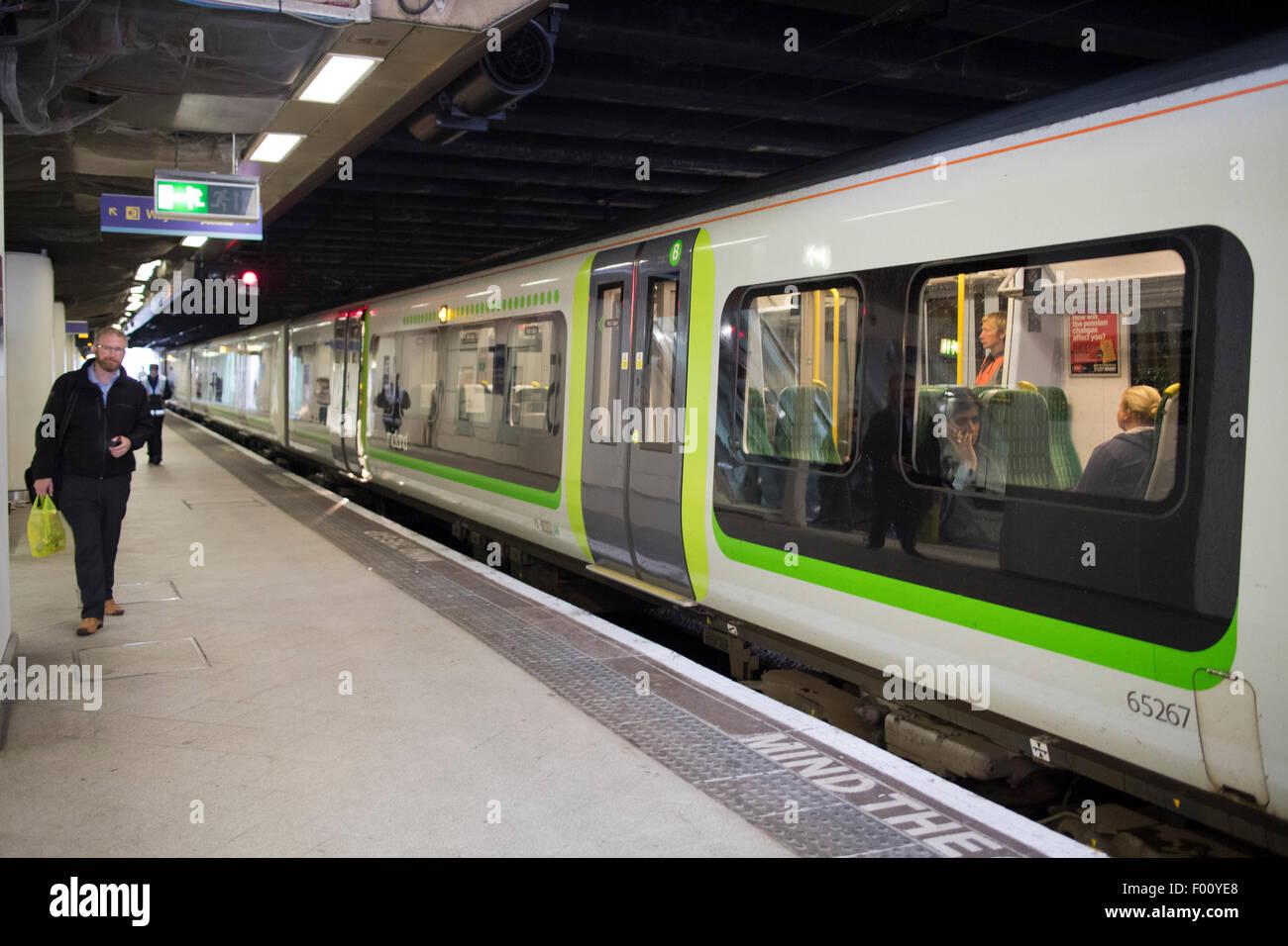 london midland train on the platform at birmingham new street station england uk - Stock Image