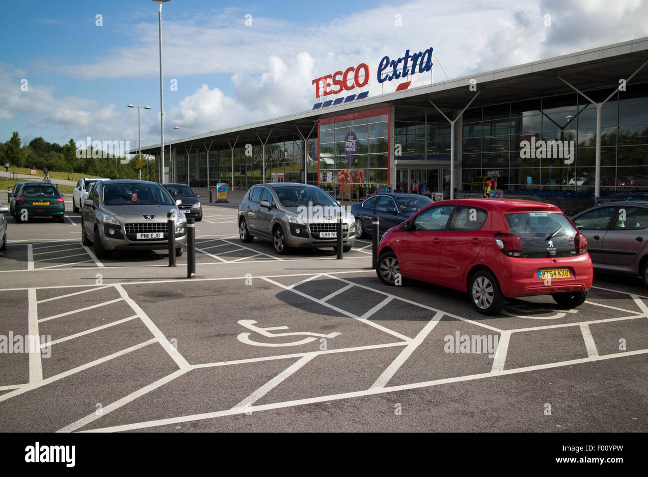 car parking disabled spots at tesco extra superstore at st helens uk - Stock Image