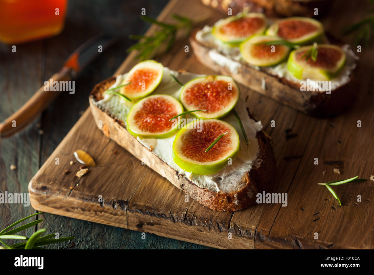 Homemade Fig and Goat Cheese Toast with Rosemary and Honey - Stock Image