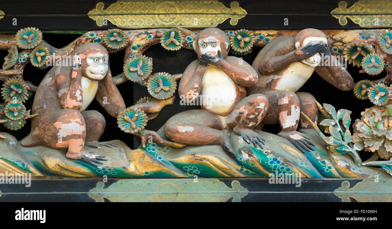 Hear No Evil, Speak No Evil, See No Evil wood carving of monkeys above the Shinkyusha (sacred stable) for horses - Stock Image