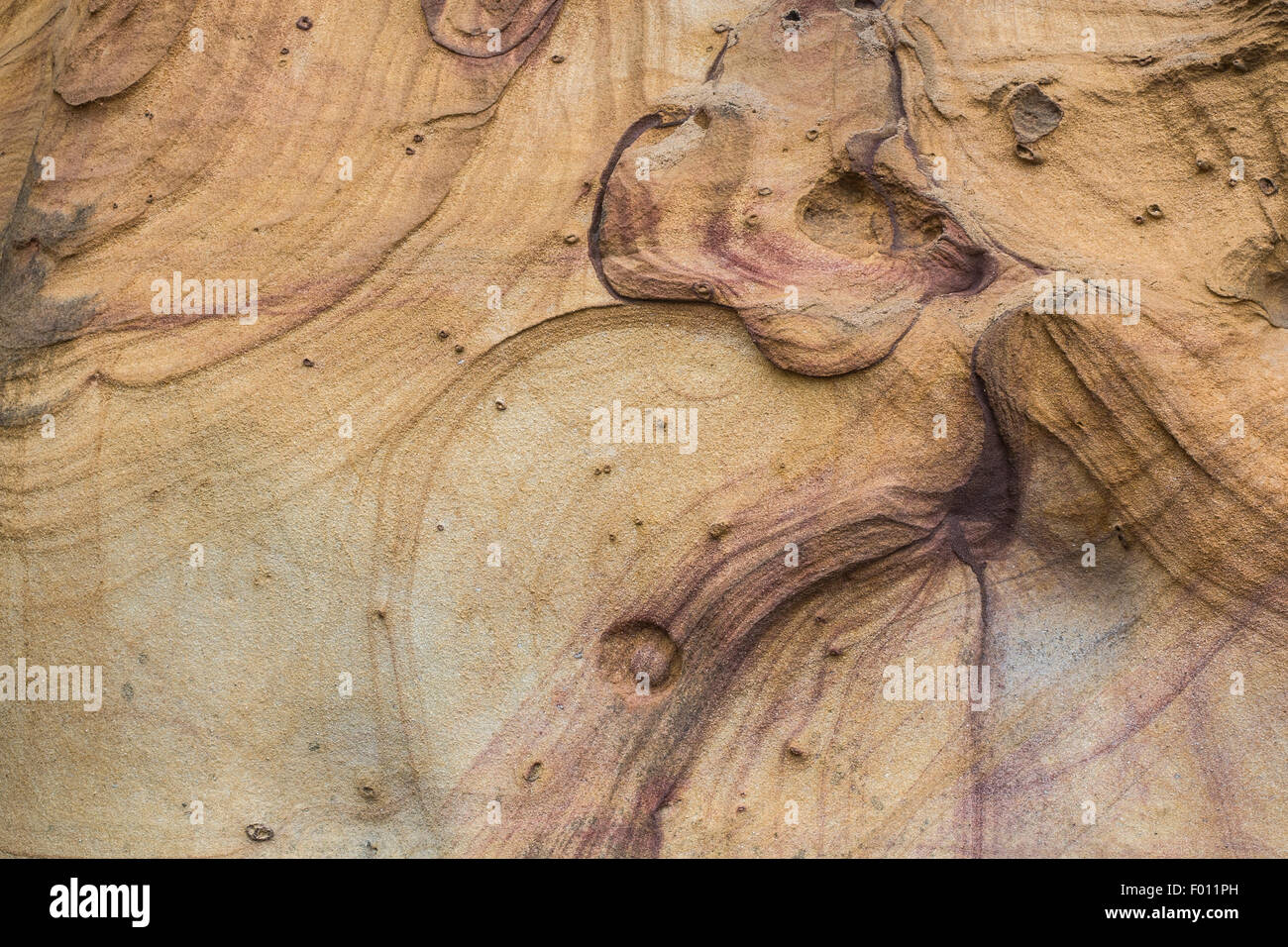 Abstract pattern in a natural sandstone cliff. Stock Photo