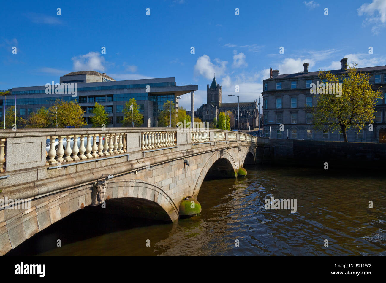 O'Donovan Rossa Bridge (1813) with Christchurch Cathedral and  Dublin Corporation Civic Offices on Wood Quay. - Stock Image