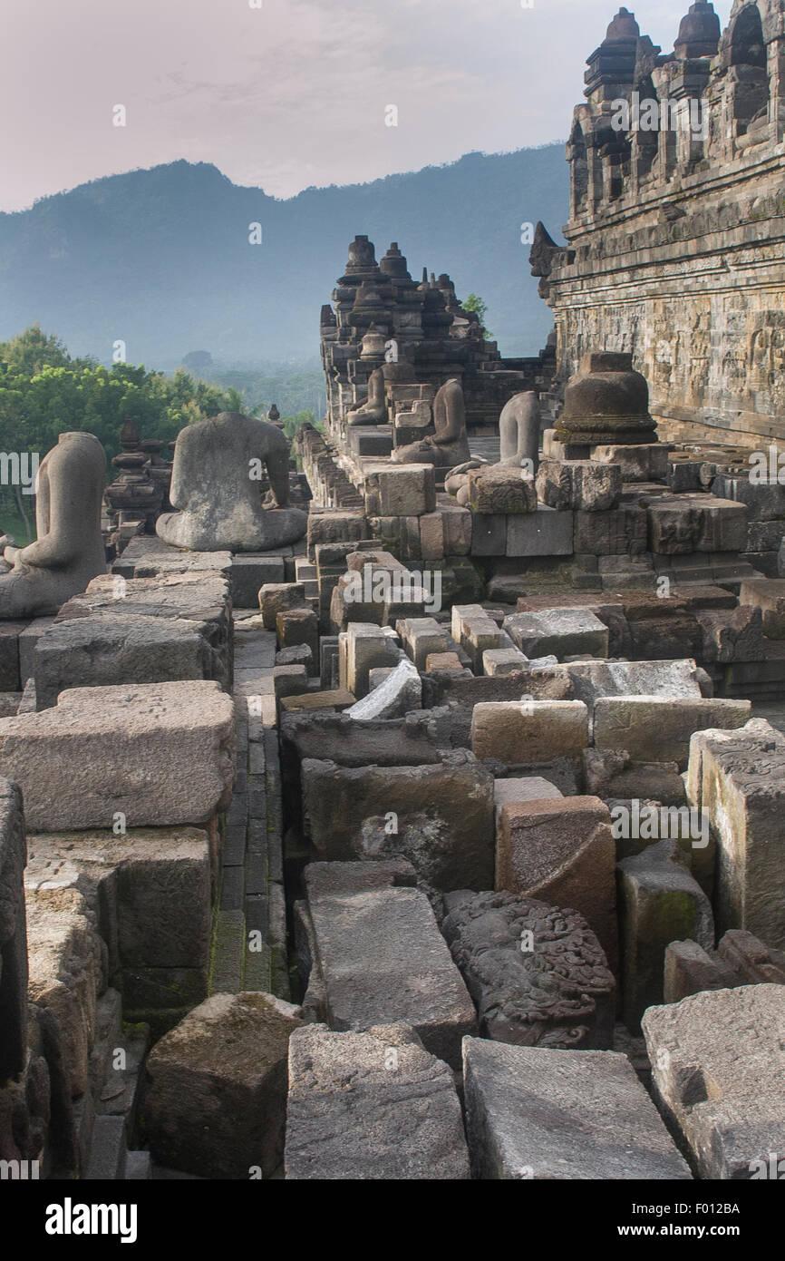 Jumble of stone blocks at the 9th-century Buddhist temple, Borobudur, of Java, Indonesia. - Stock Image