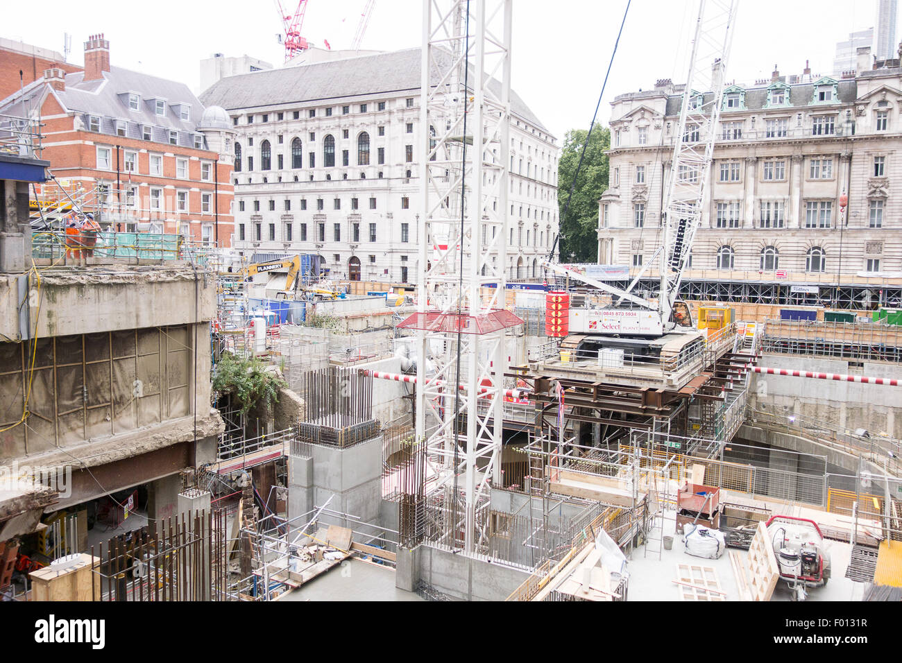Two workmen resting above the Crossrail shaft at Moorgate Station. - Stock Image