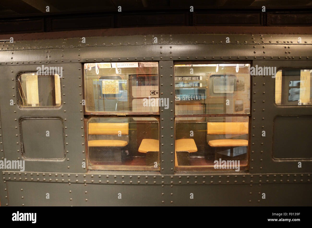 New York Transit Museum 1930 carriage subway vintage subway signs adverts rattan benches - Stock Image