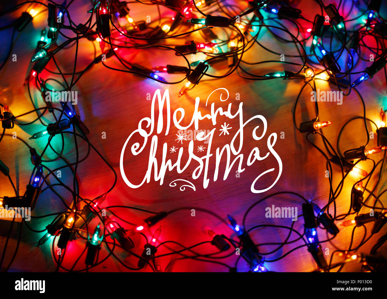 Christmas lights frame on wood background with Merry Christmas Stock ...