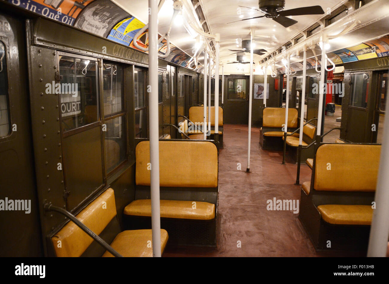 New York Transit Museum 1930 carriage subway vintage subway signs adverts rattan benches green livery exterior special - Stock Image
