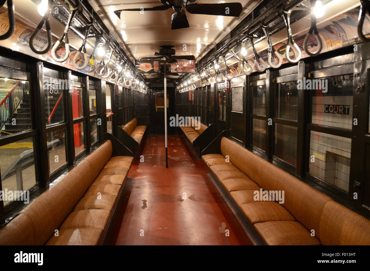 New York Transit Museum 1904 carriage subway vintage subway signs adverts rattan benches green livery exterior special - Stock Image