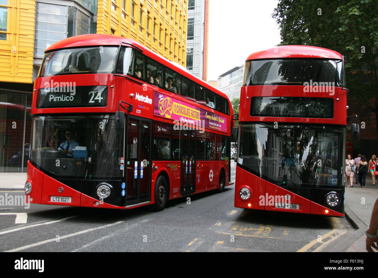 TWO RED LONDON NEW ROUTEMASTER BUSES PICTURED TOGETHER - Stock Image