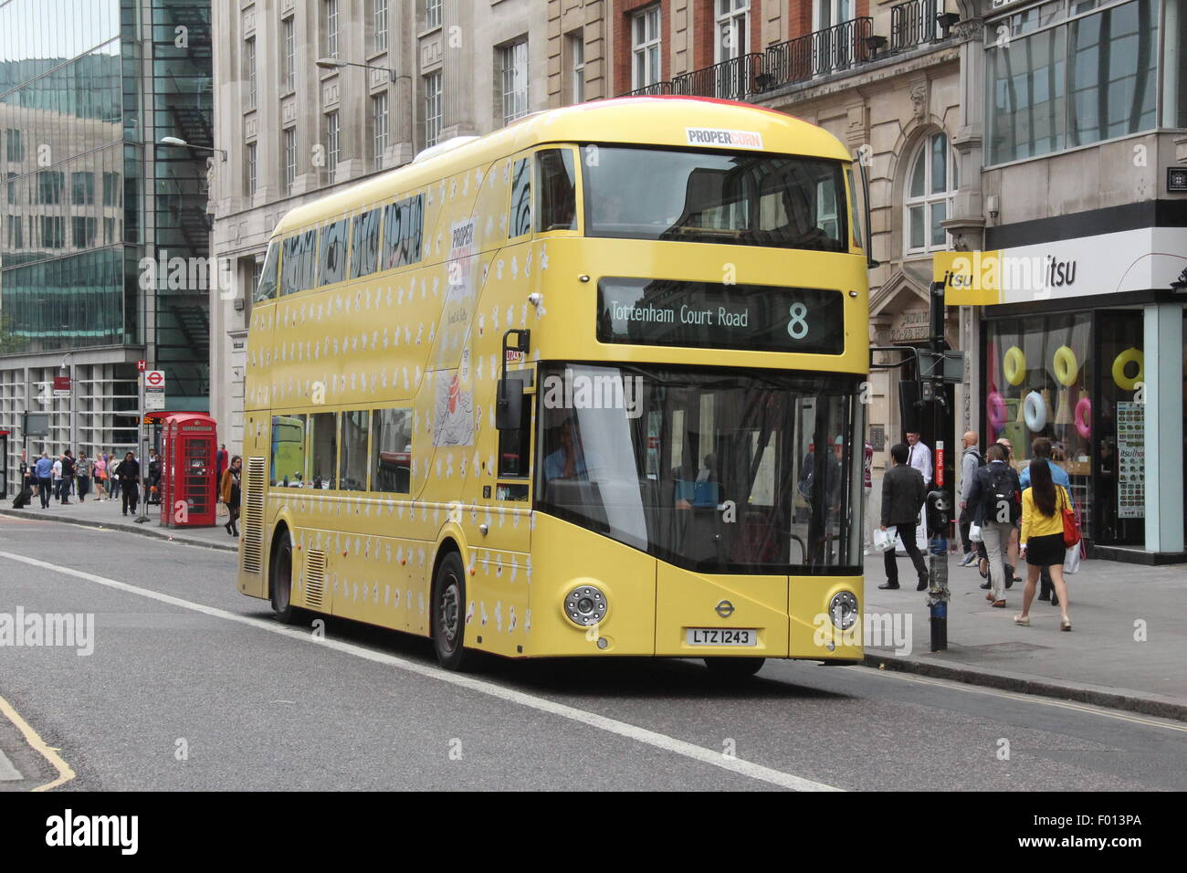 A New Routemaster London bus in a yellow advertising livery for proper corn - Stock Image