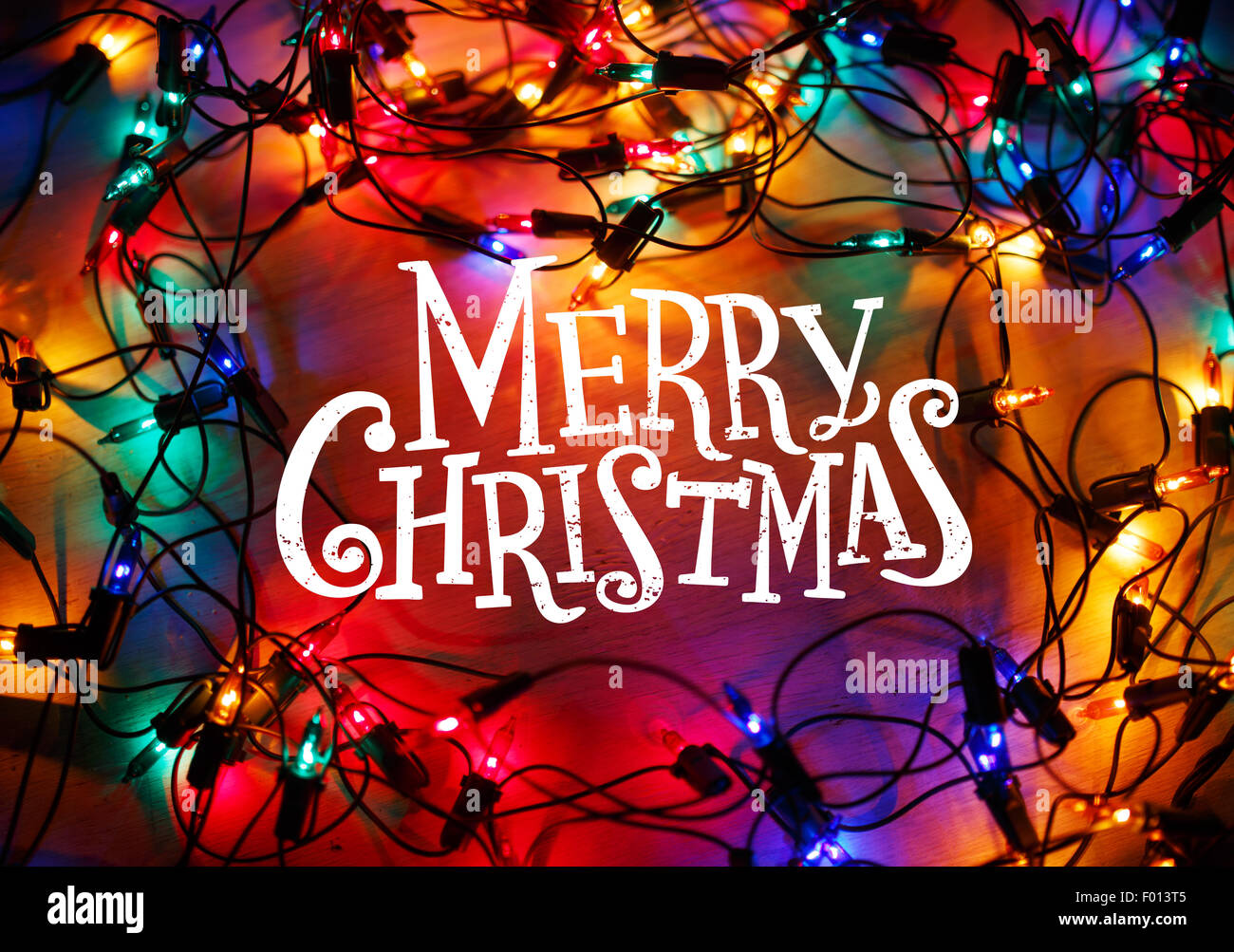 christmas lights frame on wood background with merry christmas lettering stock image - Christmas Lights Frame
