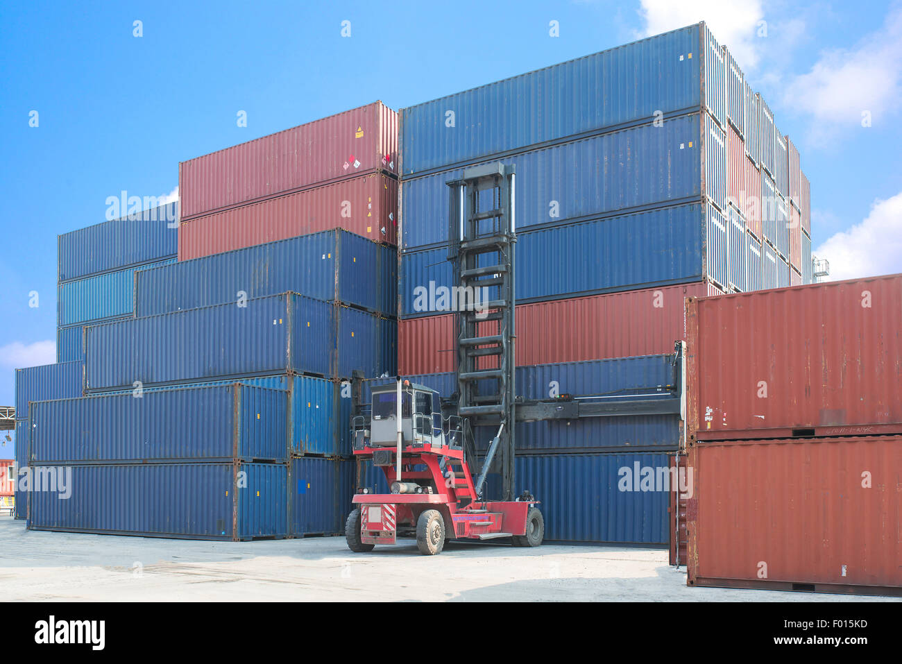 forklift handling container box loading to truck in import export logistic zone - Stock Image