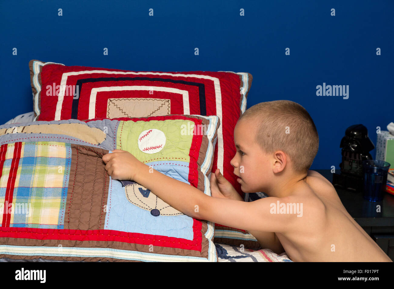 Young Boy (Seven Years Old) Making His Bed in the Morning.  MR - Stock Image