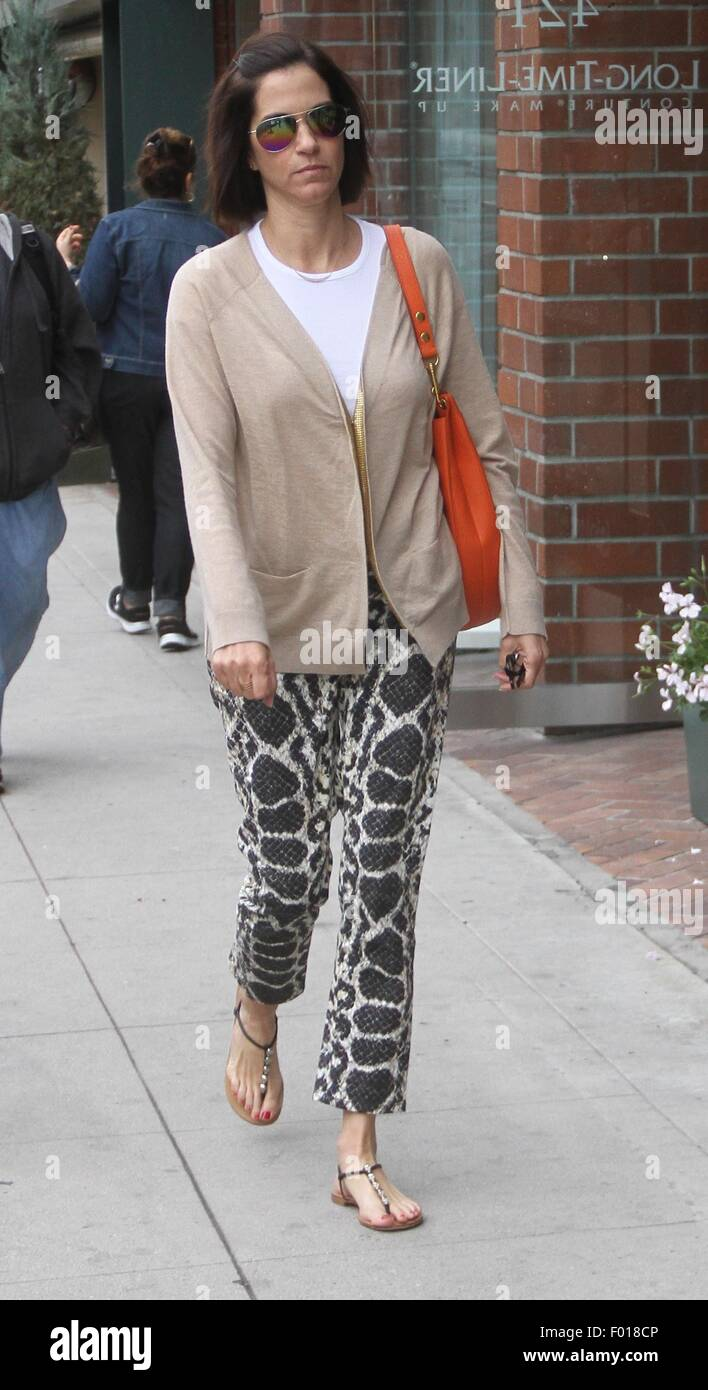 Jami gertz chatting on her phone shopping in beverly hills new pictures
