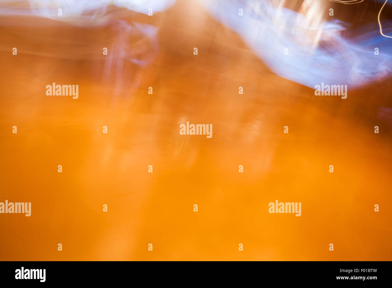 Abstract photo of motion and lights in orange and blue colors. - Stock Image