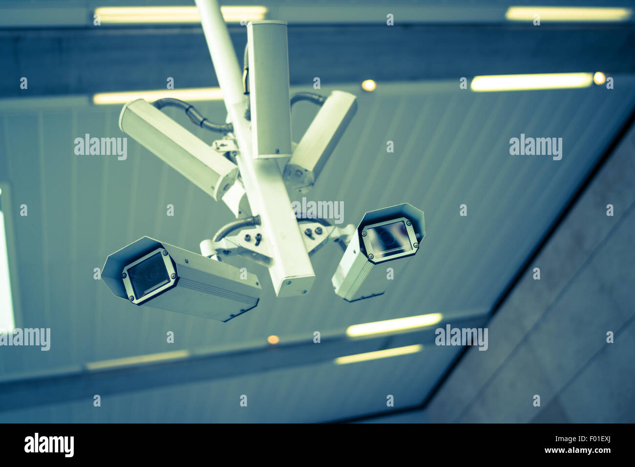 A CCTV camera in a north London station. - Stock Image