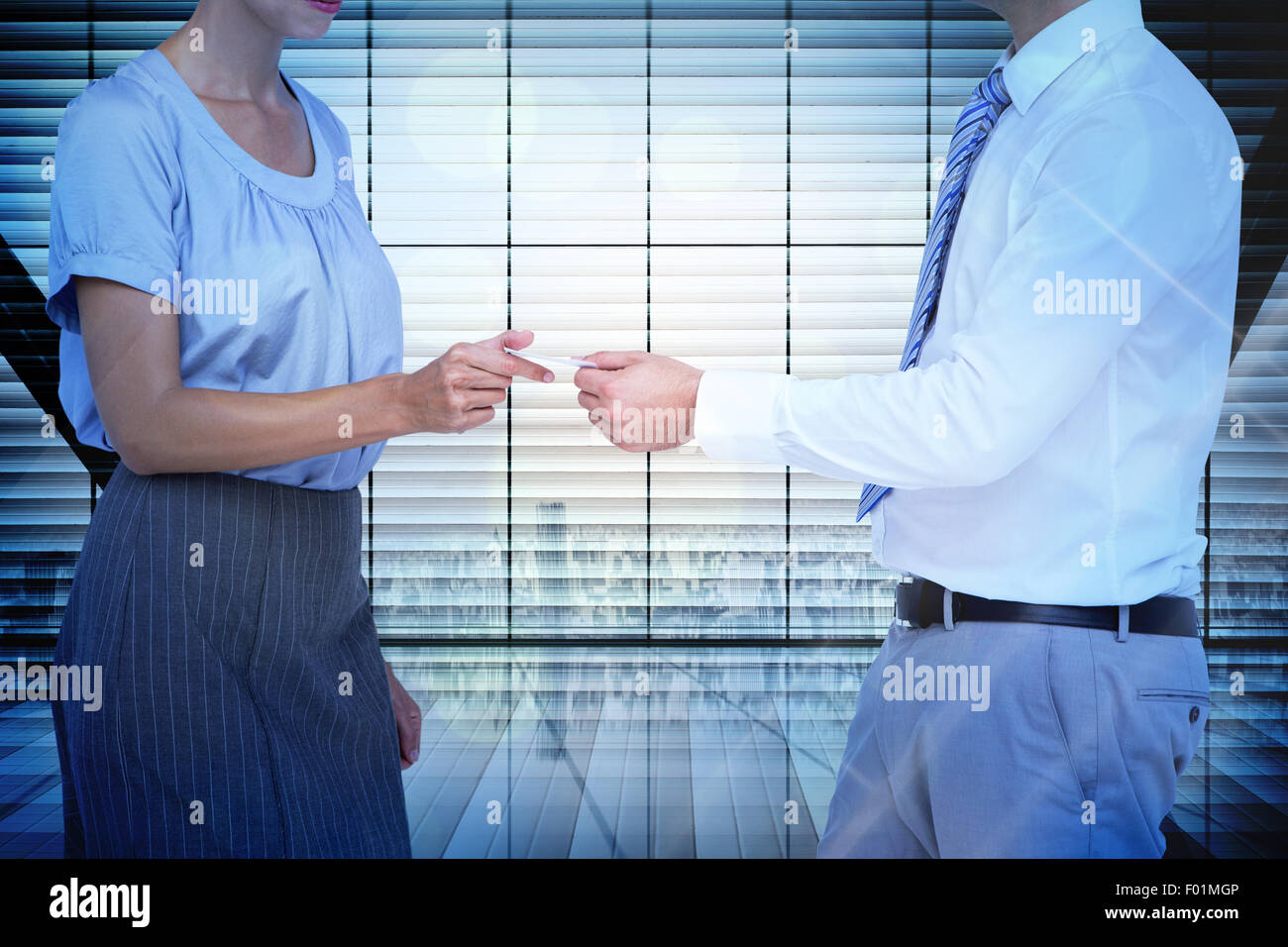 Composite image of business people exchanging business card - Stock Image