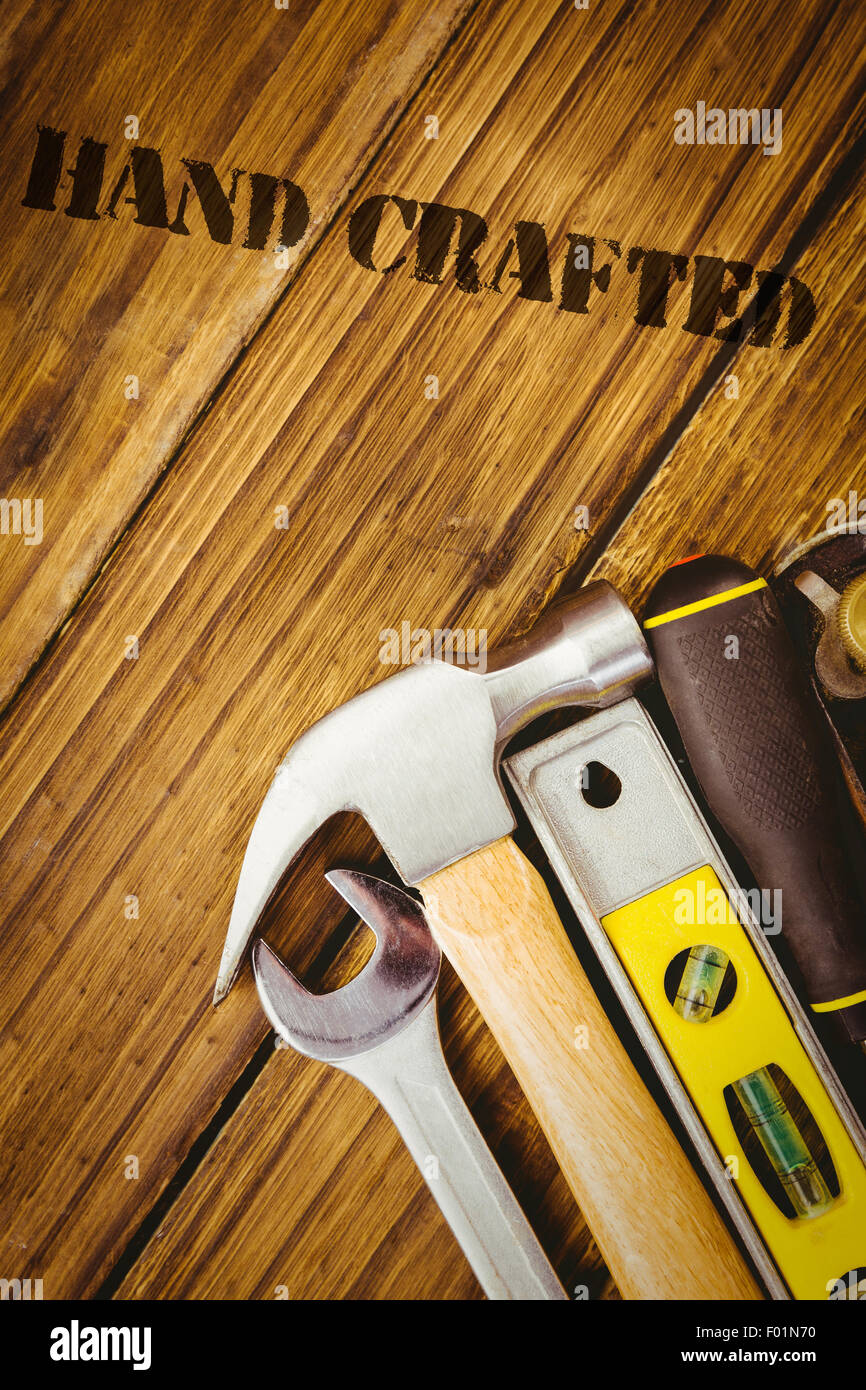 Hand crafted against desk with tools - Stock Image