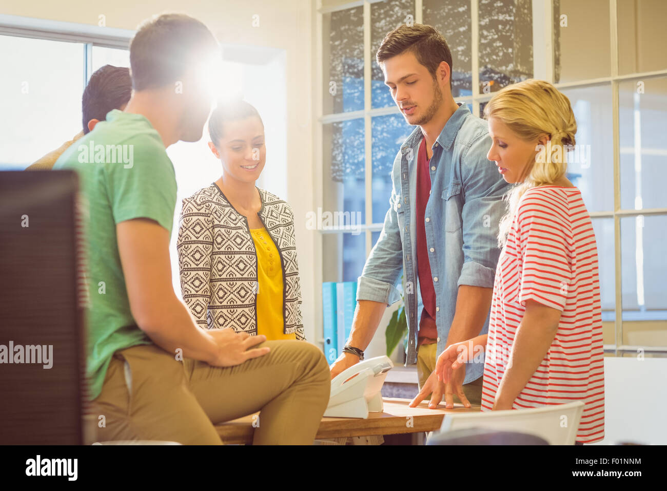 Casual business people speaking together - Stock Image
