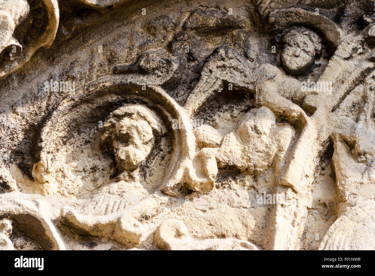 Barfreston Norman church of St Nicholas, 12th century, tympanum above south door, Angelic hosts supporting the Vesica - Stock Image