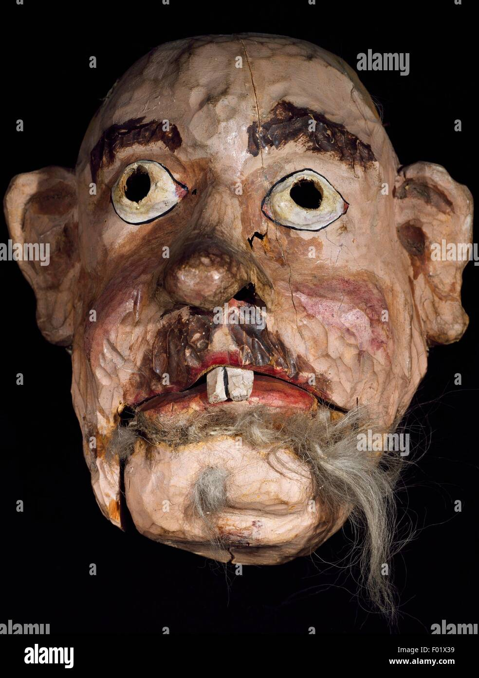Wooden mask for performances of popular plays from the Ahr Valley, Trentino-Alto Adige, Italy. - Stock Image