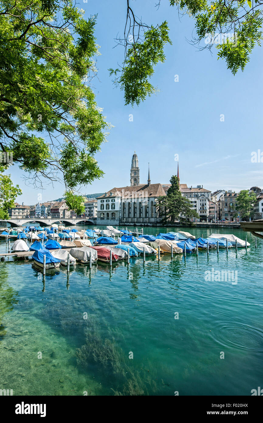 Boats in the river Limmat in Zurich. - Stock Image
