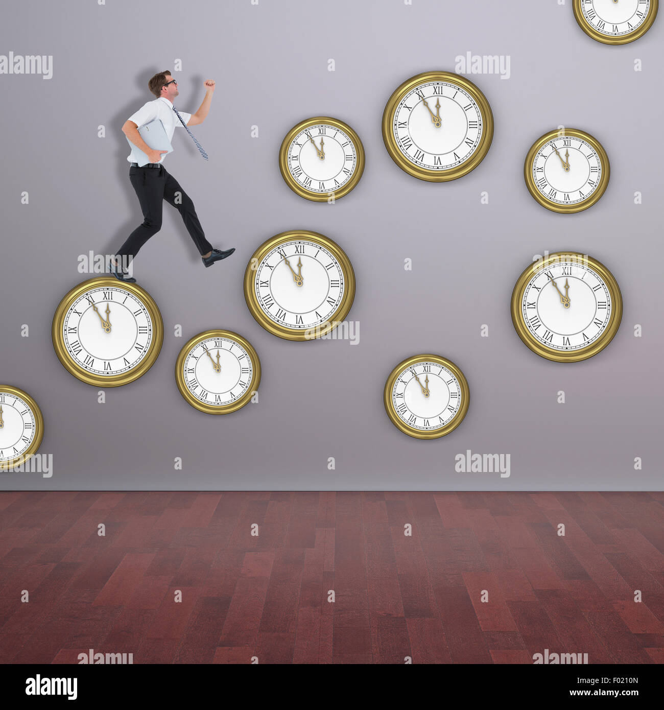 Composite image of geeky businessman running late - Stock Image