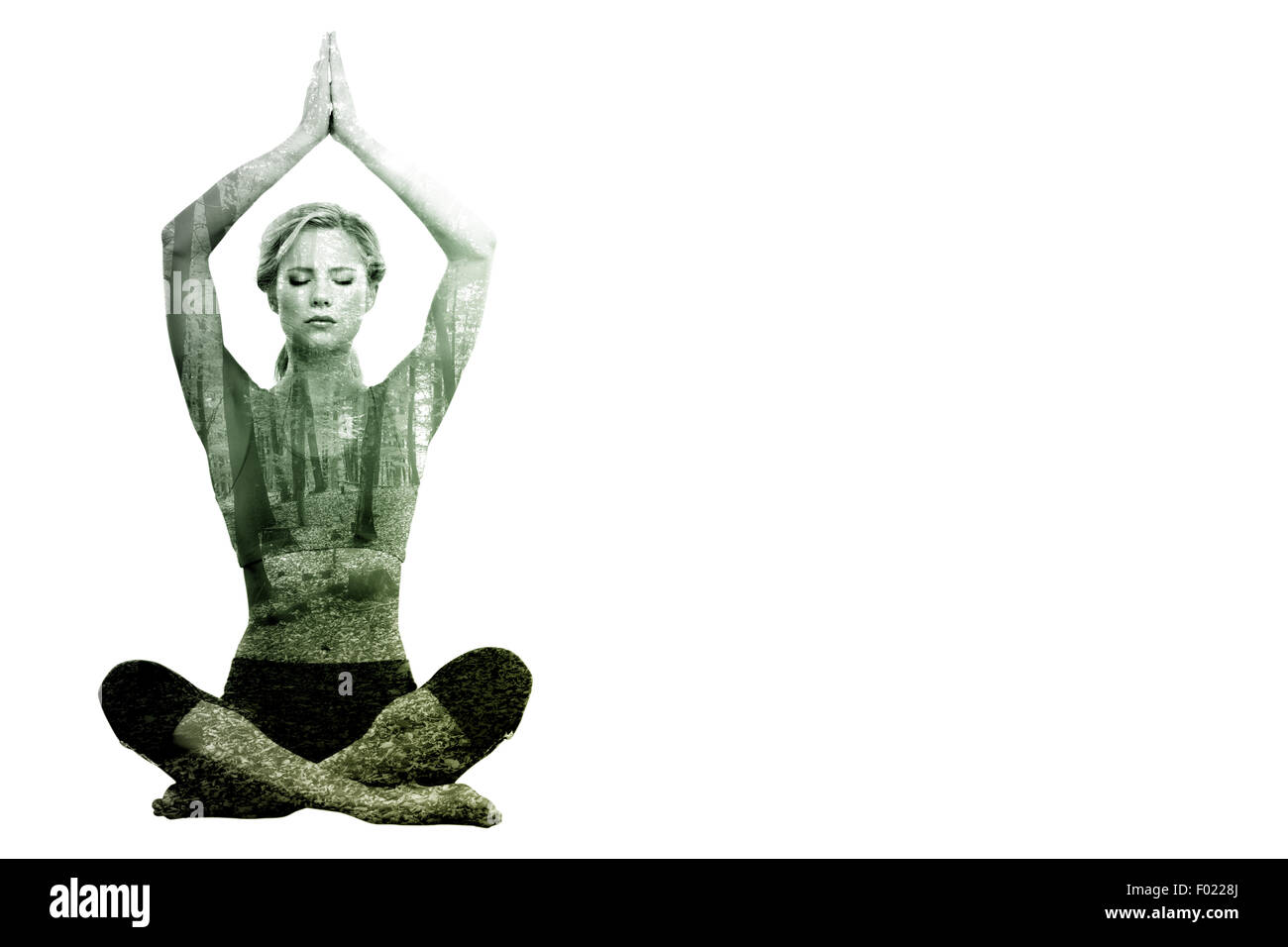 Composite image of calm blonde meditating in lotus pose with arms raised - Stock Image